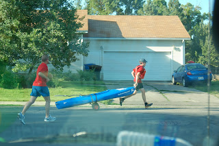 Pulling the kayak through the streets of Logan