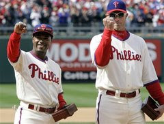 Philadelphia Phillies Jimmy Rollins, left, and right fielder Jayson Werth, right, flash their World Series Champions to the fans during the ring presentation ceremony before the start of a baseball game with the Atlanta Braves, Wednesday, April 8, 2009, in Philadelphia.