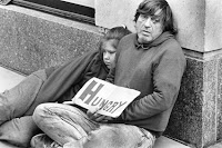 Photo of homeless father and his daughter.