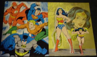 DC Comics portfolios featuring Batman, Aquaman, Flash, Superman and Wonder Woman