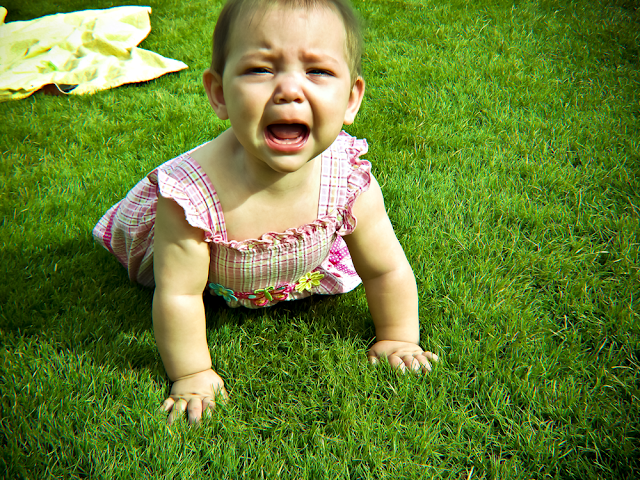Delaney screaming in the grass