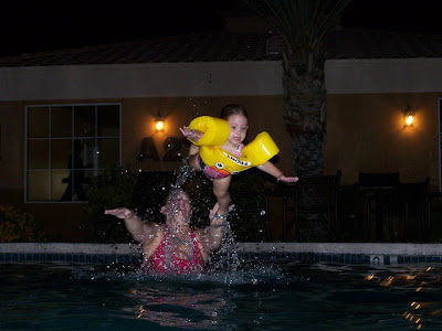 Throwing Afton through the air and into the pool