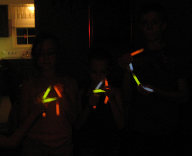 Creative kids in Arlington, Virginia spell out AAC with colored glow sticks