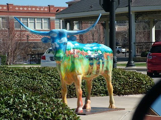 Bull sculpture with painted landscape image in Southlake Town Square