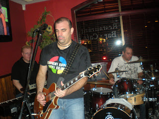 Chris Sharkey in the back, Paul Salvatoriello on bass & Glenn Gray