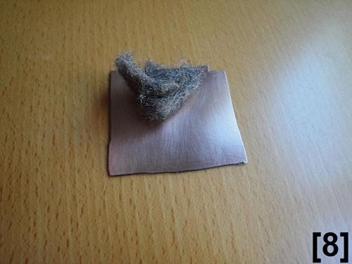 Limpieza de la placa con la fibra de acero