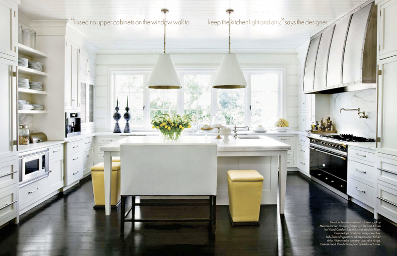 Absolutely love the clean white cabinets, dark wood floors, and