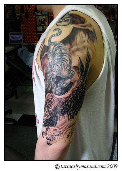 dragon tattoos black and grey. chinese dragon tattoo sleeve.