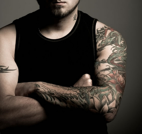 arm sleeve tattoos for guys. Tribal Arm Sleeve Tattoos.