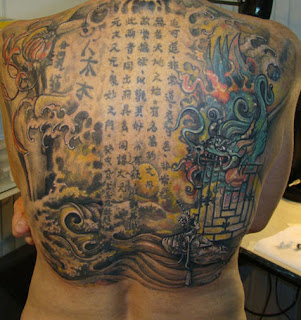 Asian themed back piece tattoo picture