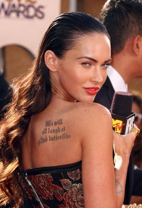 megan fox rib tattoo. Megan Fox Tattoo