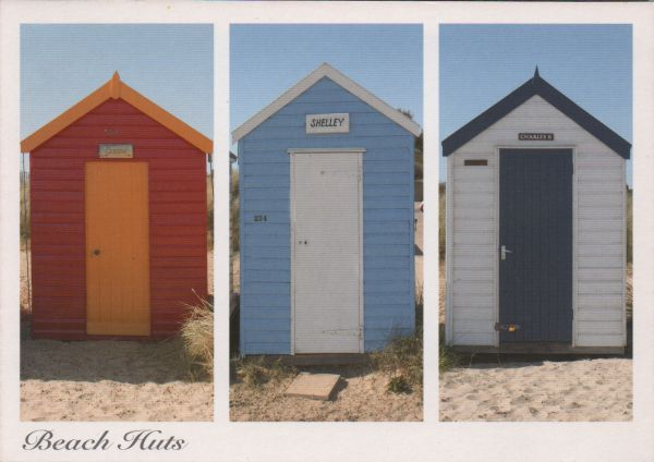three individual beach huts