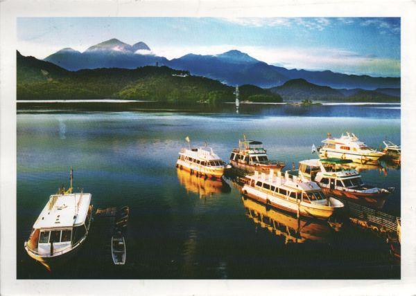postcard view of a wharf and boats on Sun Moon Lake, Taiwan