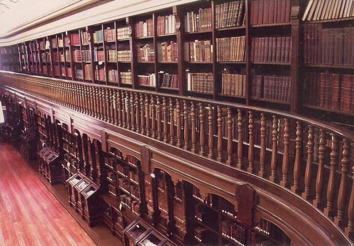beautiful old library, dark wood and leather bound books