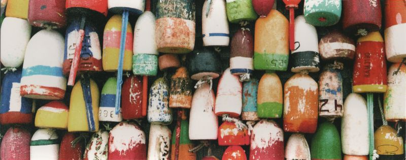 colourful old buoys hanging in the sun