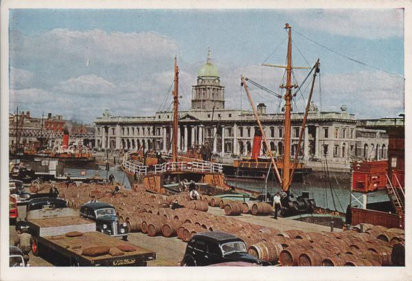 barrels being loaded onto a ship on the river Liffey