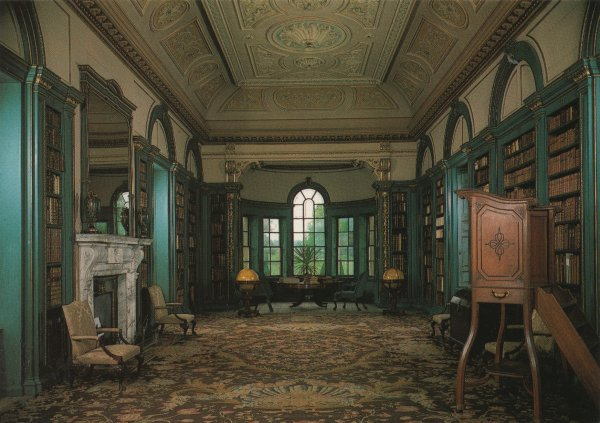 blue room lined with bookshelves, ornate ceiling