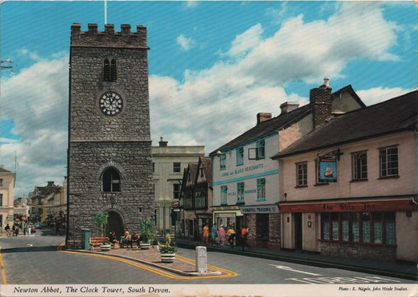stone built clock tower in centre of street