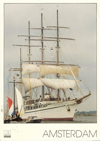 four masted white tall ship with white sails