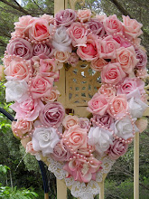 Rose and cherub wreath..