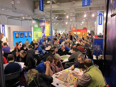 Essen Spiel 2010 - Day 2 People playing games everywhere