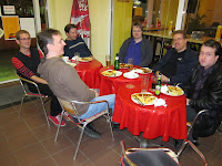 Essen Spiel 2010 - Day 3 The team (Phil, Ben, Rob, Daniel, Simon and Ian) eating dinner - Curry brakwurst - hmmm