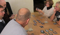The players in a game of Dominion considering their next action