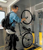 Image of bicyclist racking bike on Amtrak Capitol Corridor in California