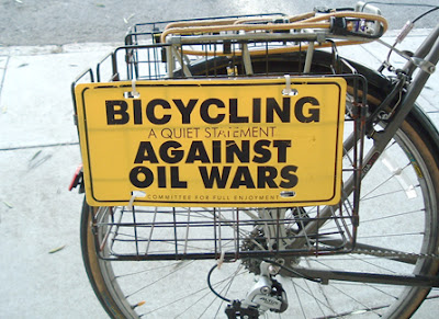 Image of bicycle with bicycling against oil wars plastic plate