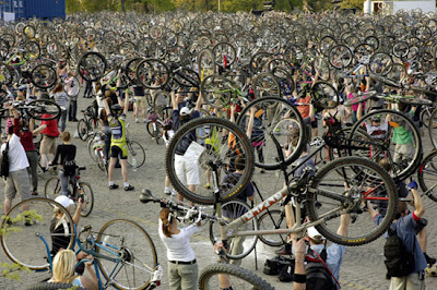 Image of Critical Mass cyclists raising bikes