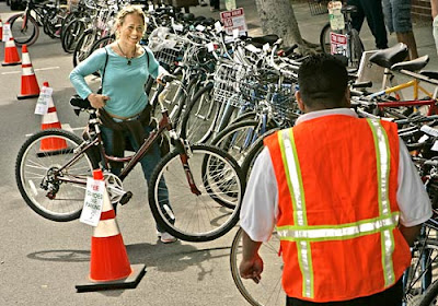 Image of bicyclist at valet bike parking in Santa Monica