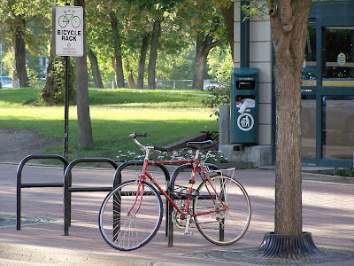 Image of a bicycle parked near an Edmonton transit stop