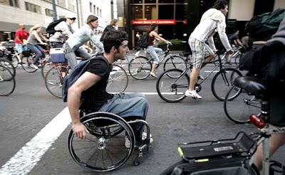 Image of man in wheelchair participating in San Francisco's Critical Mass in April 2007