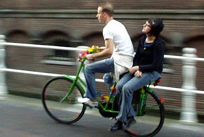 Image of bicyclist with passenger on rear rack