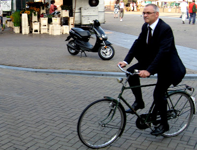 Image of bicyclist in a suit