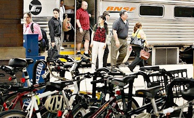 Image of crowded bike rack at Metra station