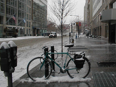 Image of parked bicycle on snowy street
