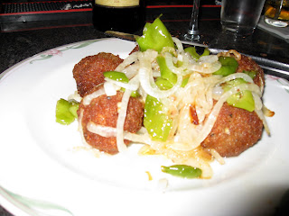 Fried meatballs with onions and peppers