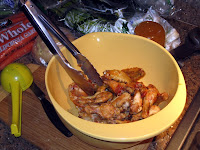 Toss baked wings with chili sauce