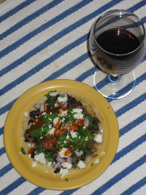 Pork & black bean tostada and wine glass