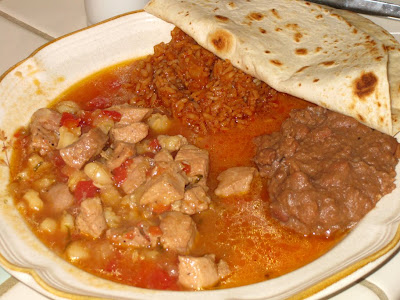 Pork & hominy stew with Mexican rice and refried beans