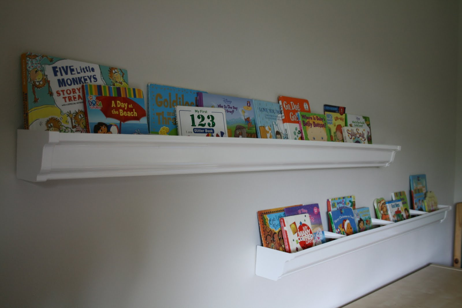 Amazing photo of Somes Home: Rain Gutter Bookshelves  with #2D4B67 color and 1600x1067 pixels