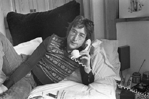 John Lennon at home on the telephone
