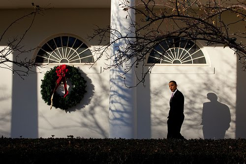President Obama whistling by Pete Souza