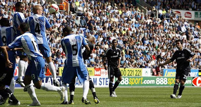 In a moment of brilliance, Deco (far right) lets fly to score the winner for Chelsea during their away match at Wigan yesterday. The Blues are now top of the early Premier League table