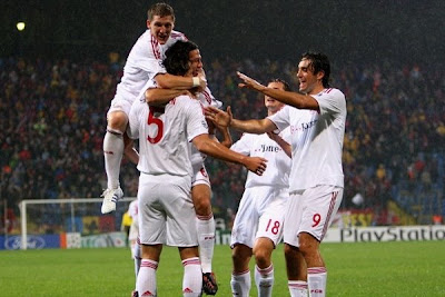 Daniel Van Buyten is mobbed by his team-mates after putting Bayern ahead