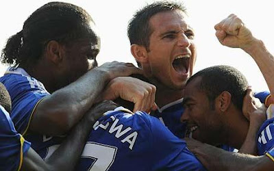 Stoking the fire: Chelsea celebrate their opener after dogged determination from the hosts