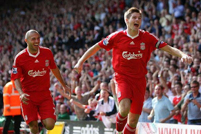 Liverpool captain Steven Gerrard wheels away in celebration, thinking he had netted the opening goal early on against Stoke City. It was contentiously chalked off and the game surprisingly ended goalless.