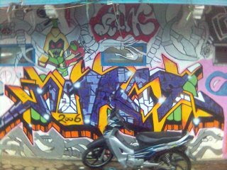 Motorcycles and Colorful Graffiti Alphabet