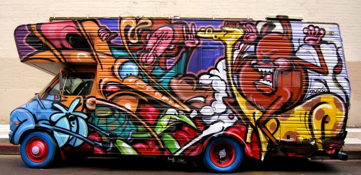 Graffiti cartoon character on the box car. Bright with colorful graffiti